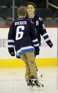 Justin Bieber & Selena Gomez Kissing at Hockey Game in Canada  picture